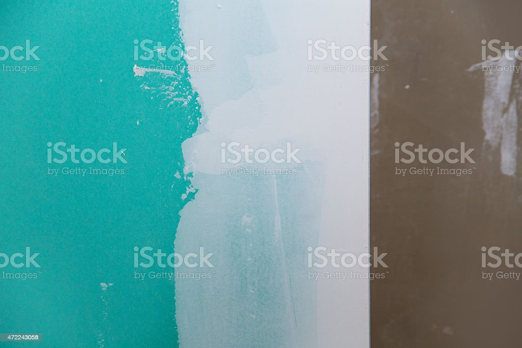 drywall hydrophobic plasterboard in green plaster seam stock photo