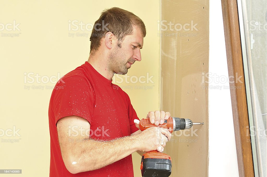 Drywall worker. stock photo
