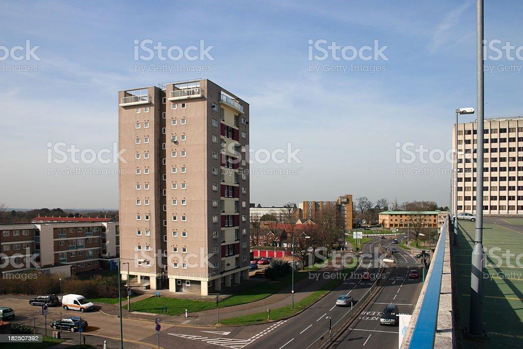 dual carriageway road in town social housing tower block royalty-free stock photo