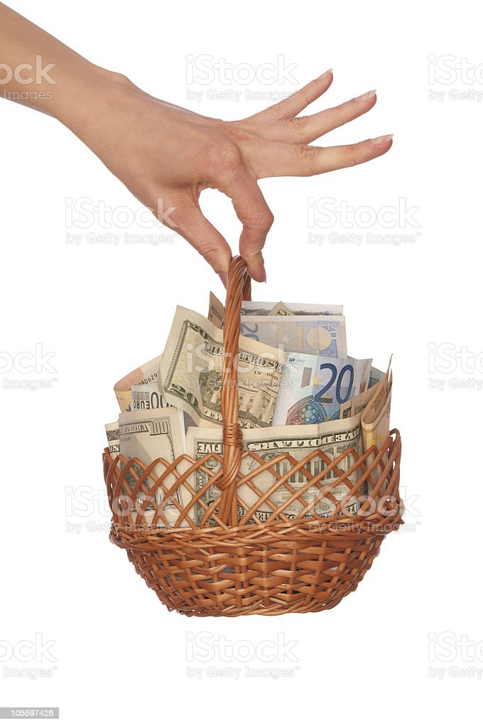 Dual currency basket with money royalty-free stock photo