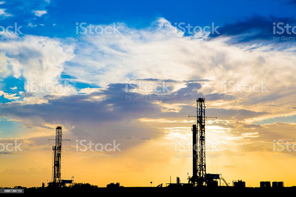 Dual Fracking Platforms at Sunset. stock photo