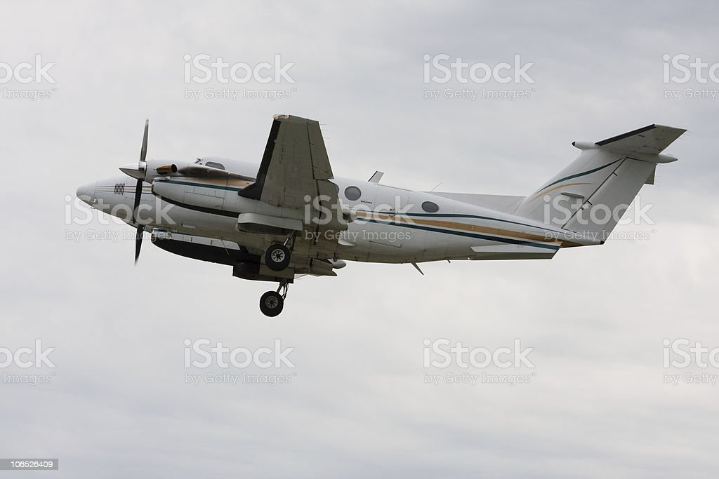 Dual prop aircraft soon after takeoff stock photo