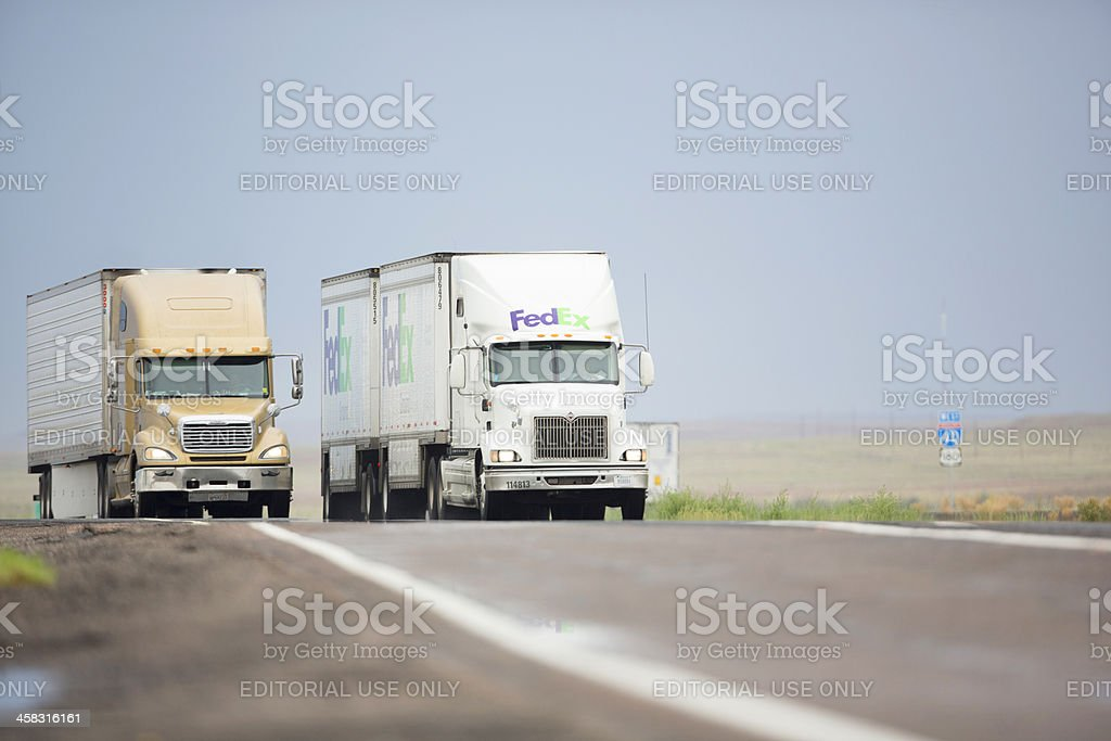 Dual trailer Federal Express Rig on interstate royalty-free stock photo