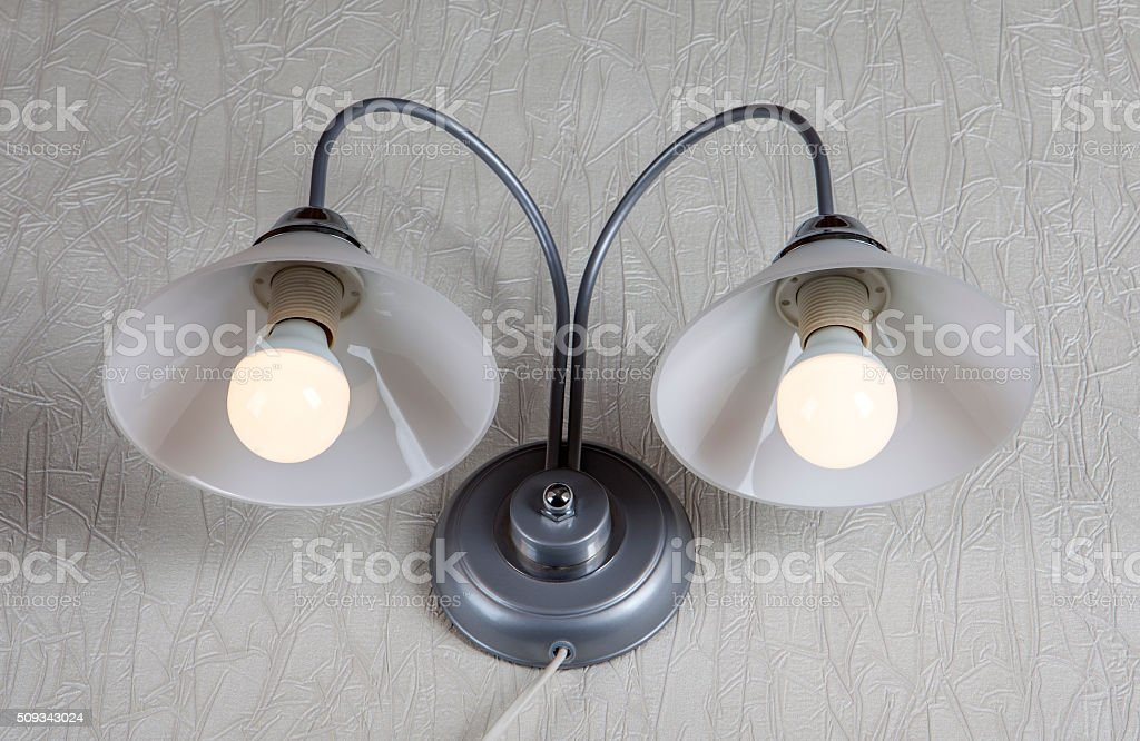 Dual wall luminaire ground glass with two LED lamps. stock photo