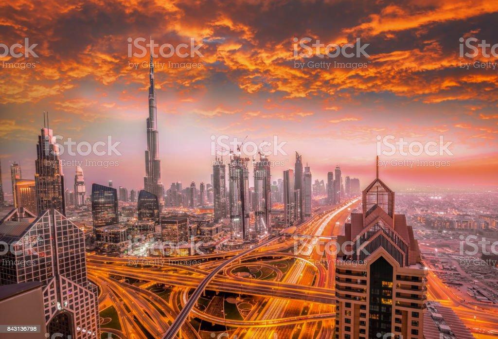Dubai against colorful sunset with modern futuristic architecture , United Arab Emirates stock photo
