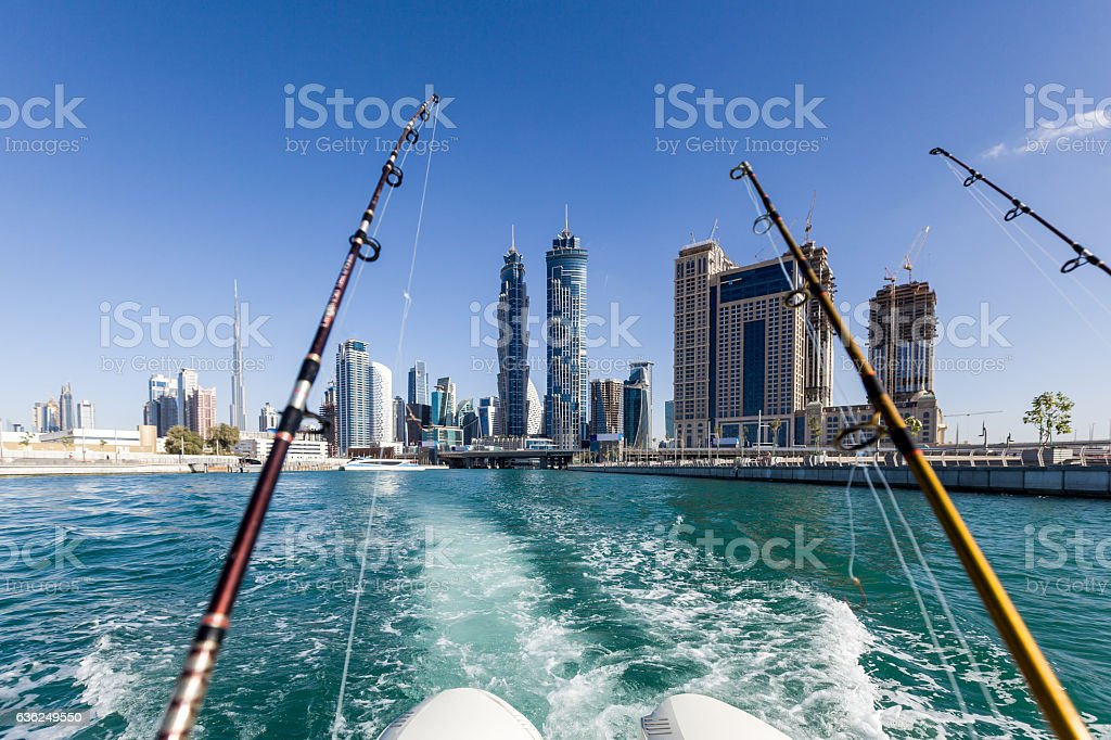 Dubai canal as seen on a fishing boat cruising over. stock photo