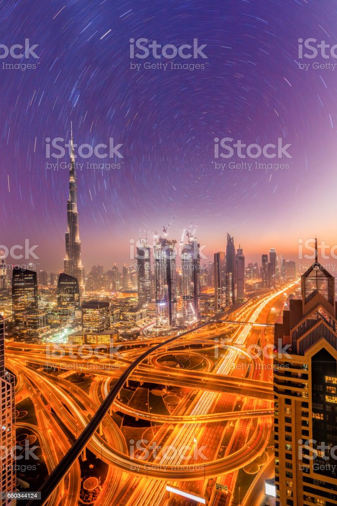 Dubai city at night under a starry sky in United Arab Emirates stock photo