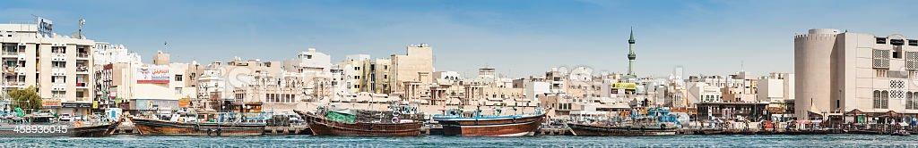 Dubai Creek dows and minarets waterfront panorama royalty-free stock photo