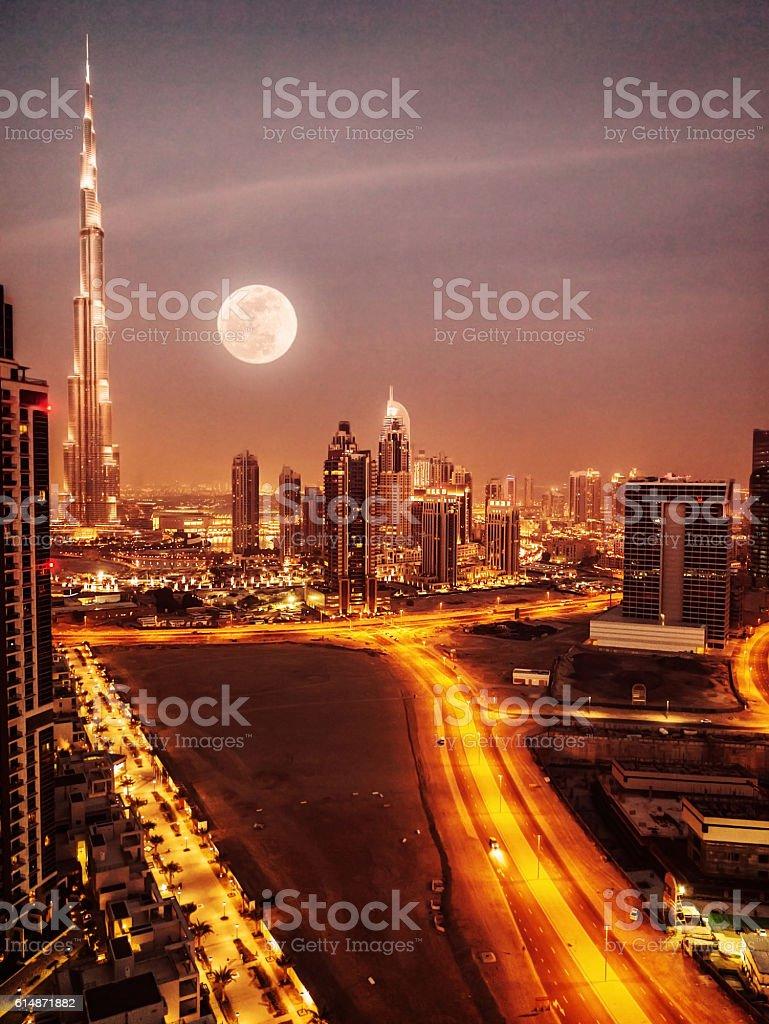 Dubai in moonlight stock photo