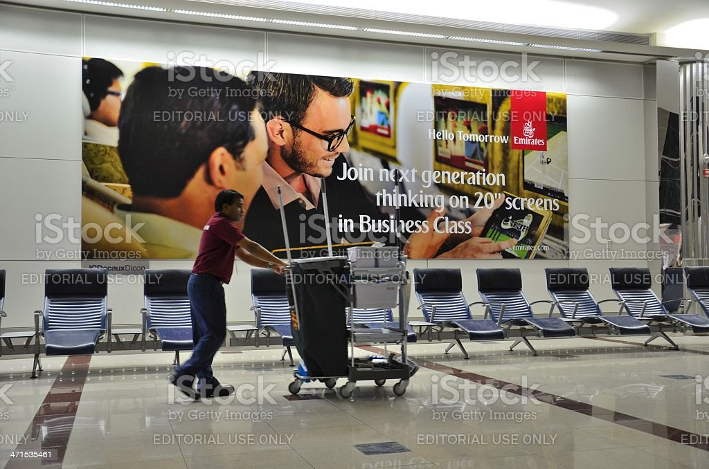 Dubai international airport departure lounge with cleaner at quiet moment royalty-free stock photo