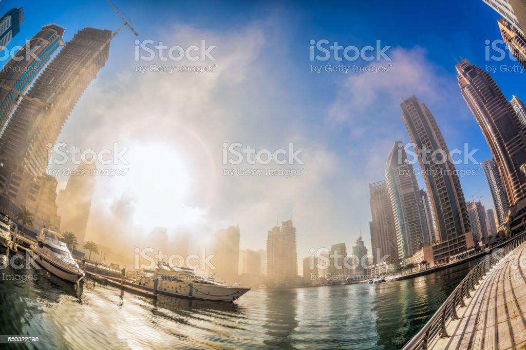 Dubai Marina is covered by early morning fog in Dubai, United Arab Emirates stock photo