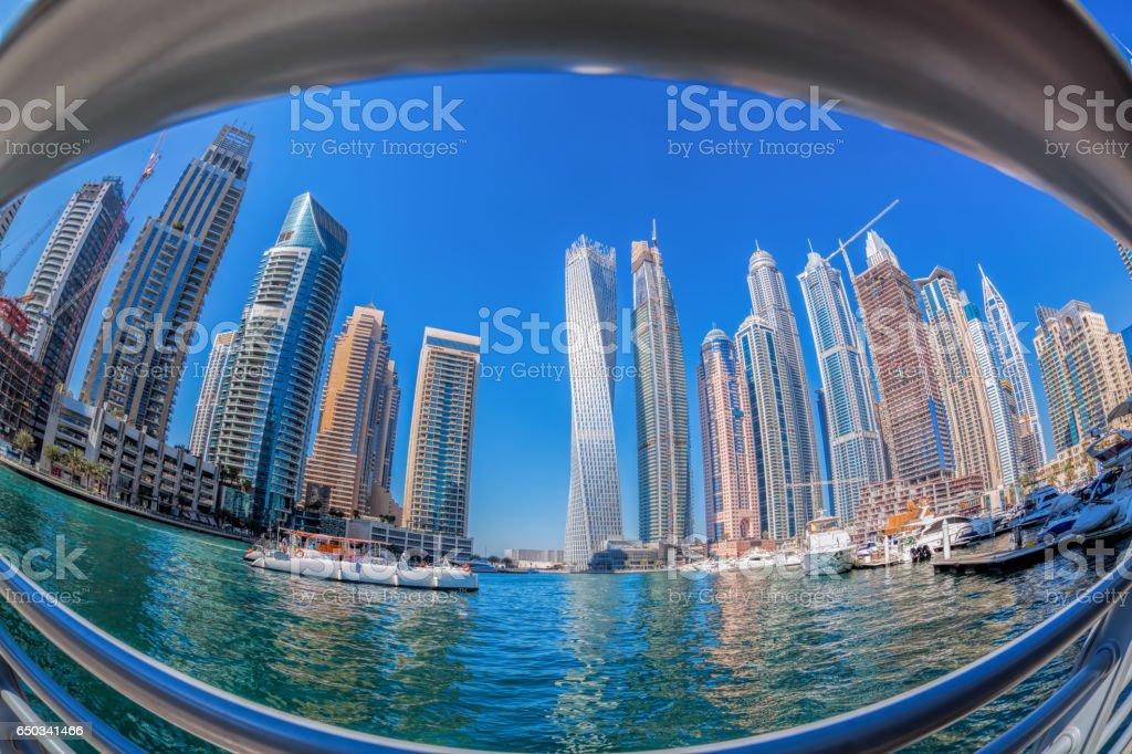 Dubai Marina with boats against skyscrapers in Dubai, United Arab Emirates stock photo