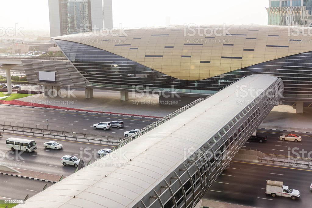 Dubai Metro Station with Cityscape and Street with Cars stock photo