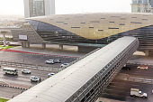 Dubai Metro Station with Cityscape and Street with Cars