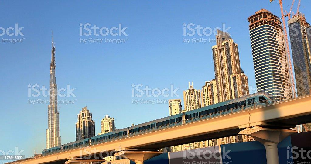 Dubai metro with khalifa tower royalty-free stock photo