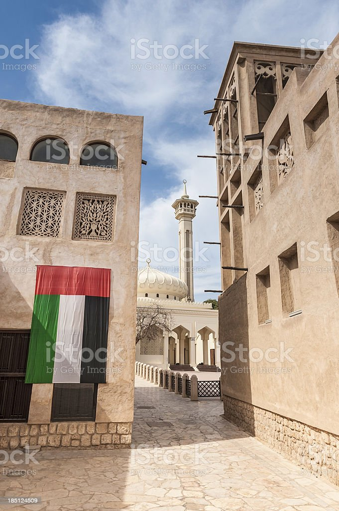 Dubai national flag mosque minaret wind tower royalty-free stock photo