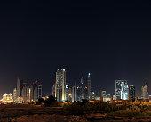 Dubai skyline at night. Dubai financial center, UAE