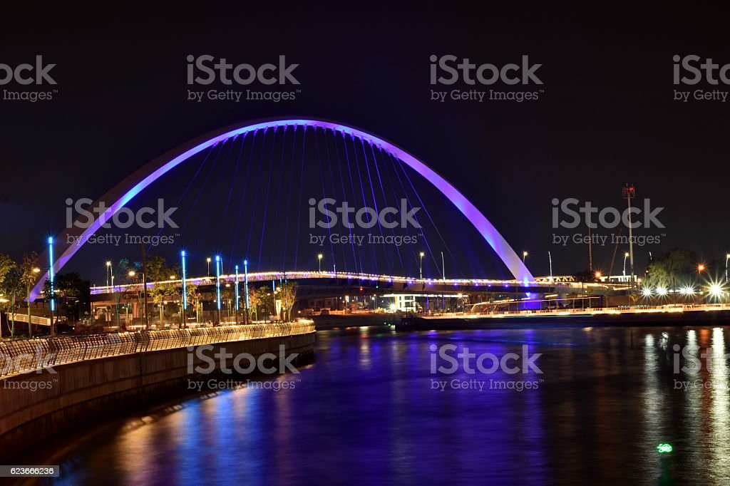Dubai Skyline at night from new Dubai Canal, U.A.E stock photo