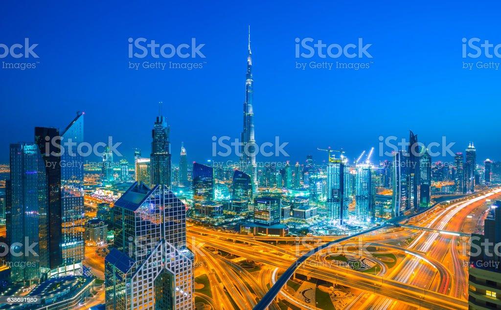 Dubai skyline at sunset and Sheikh Zayed road traffic stock photo