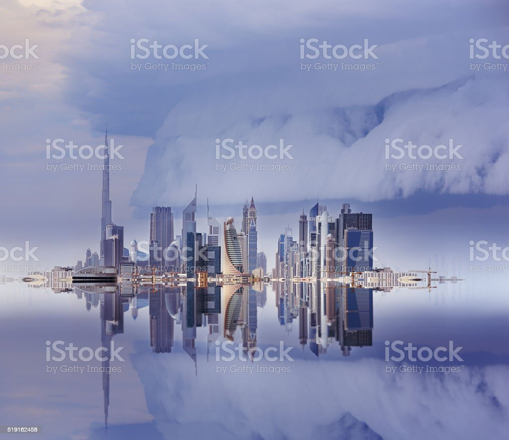 Dubai skyline reflected, stormy sky stock photo
