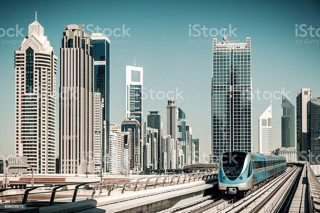 Dubai Skyline with metro stock photo