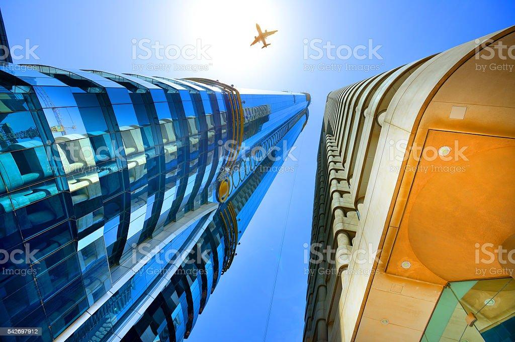 Dubai skyscrapers and airplane stock photo