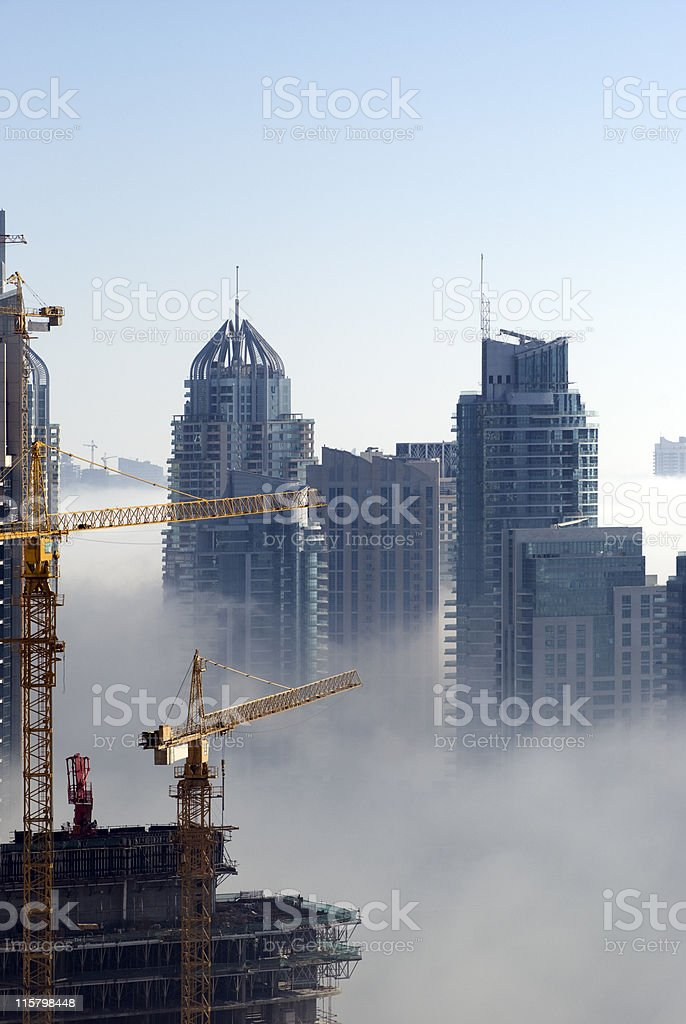 Dubai skyscrapers rising over the fog in the UAE royalty-free stock photo