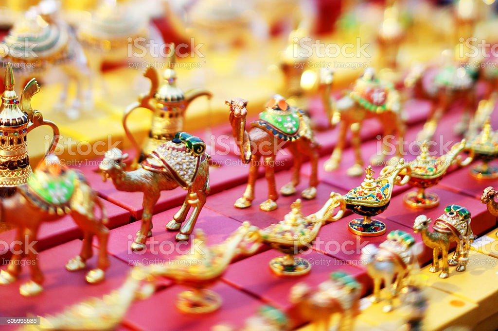 Dubai Souvenir Market Stand Golden Camels stock photo