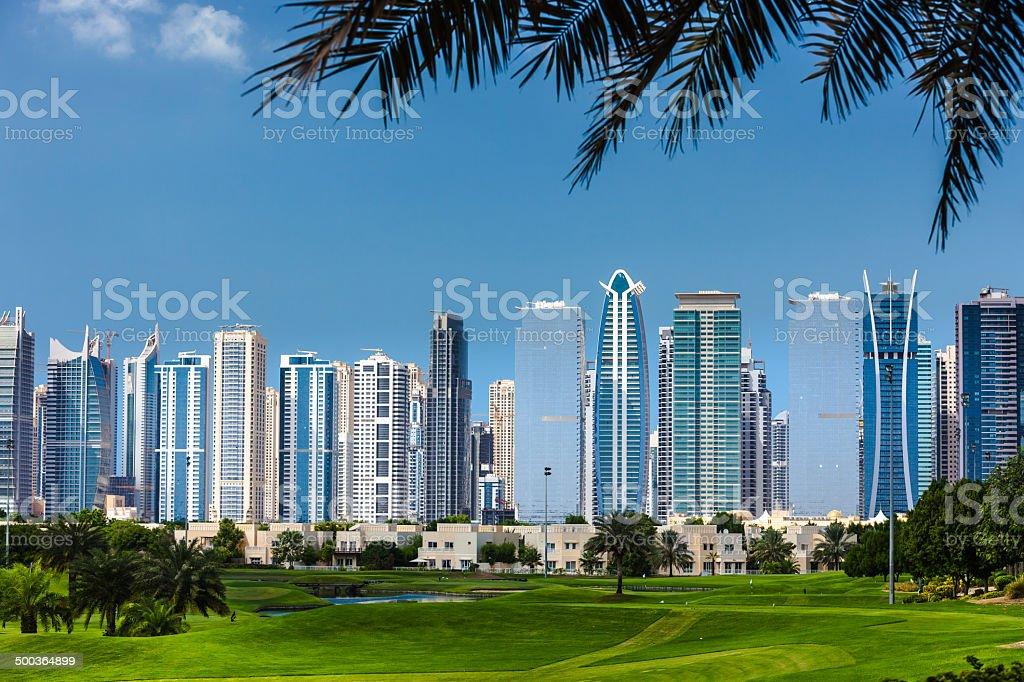 Dubai, UAE - Golf and modern skyscrapers in Arabia royalty-free stock photo