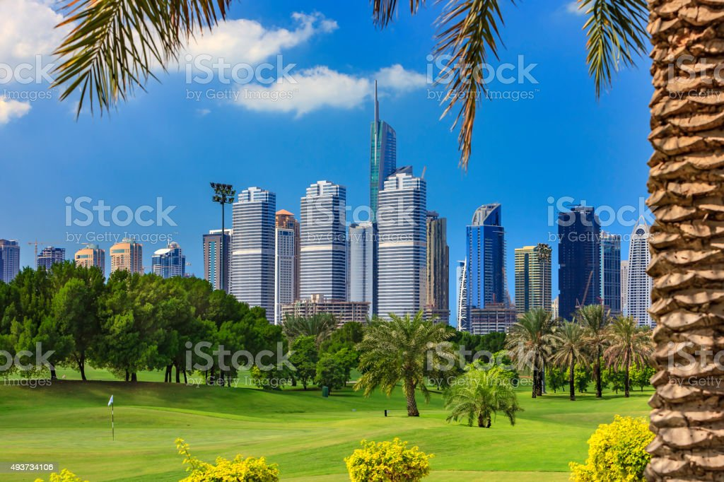 Dubai, UAE - Golf foreground; skyscrapers in the background stock photo