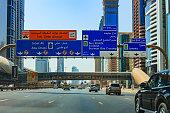 Dubai, UAE: Sheikh Zayed Road, signs for seven lanes.