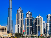 Dubai, UAE: Skyline in Bright Afternoon Sunlight from Metro Station.