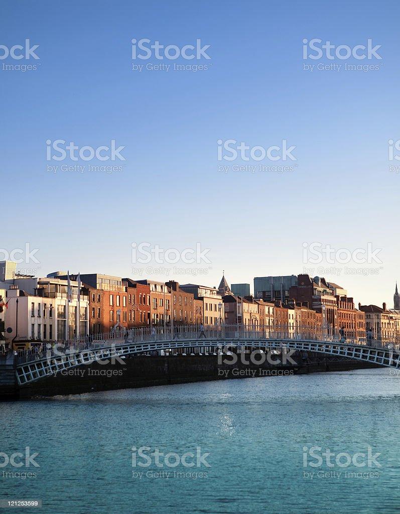Dublin and Ha'penny Bridge on Liffey River at sunset, Ireland royalty-free stock photo