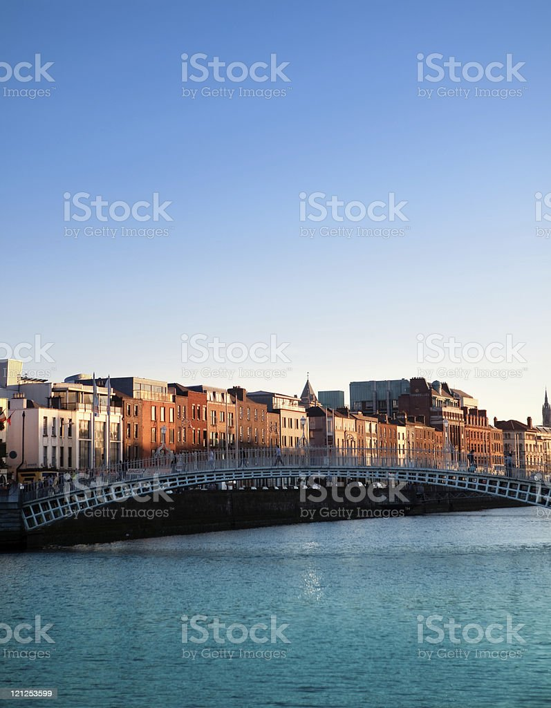 Dublin and Ha'penny Bridge on Liffey River at sunset, Ireland stock photo