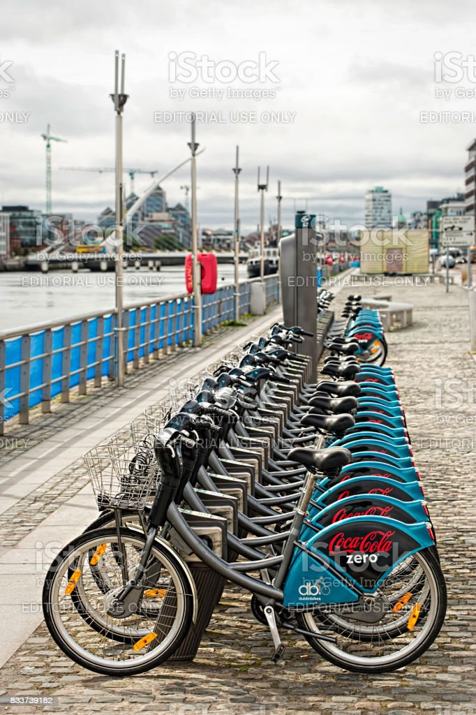 Dublin bike station located on Convention Centre, North Dock, close to Point Theatre and Liffey river, Dublin, Ireland, on cloudy, summer day, 16 August 2017 stock photo