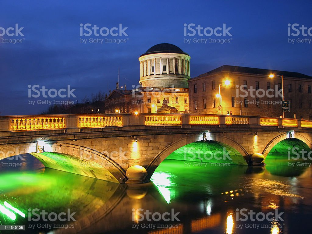 Dublin Four Courts And Bridge By Night stock photo
