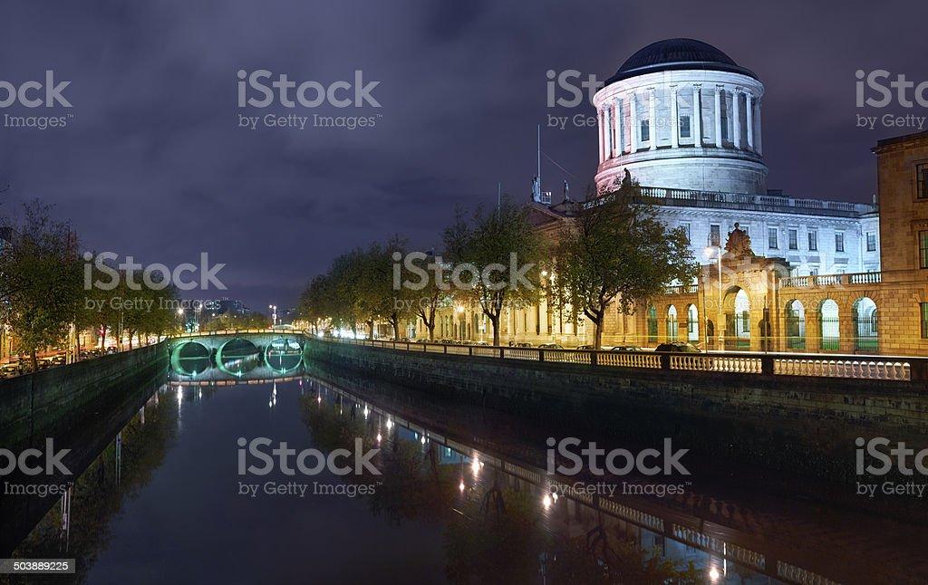 Dublin river liffey and court house illuminater at night stock photo