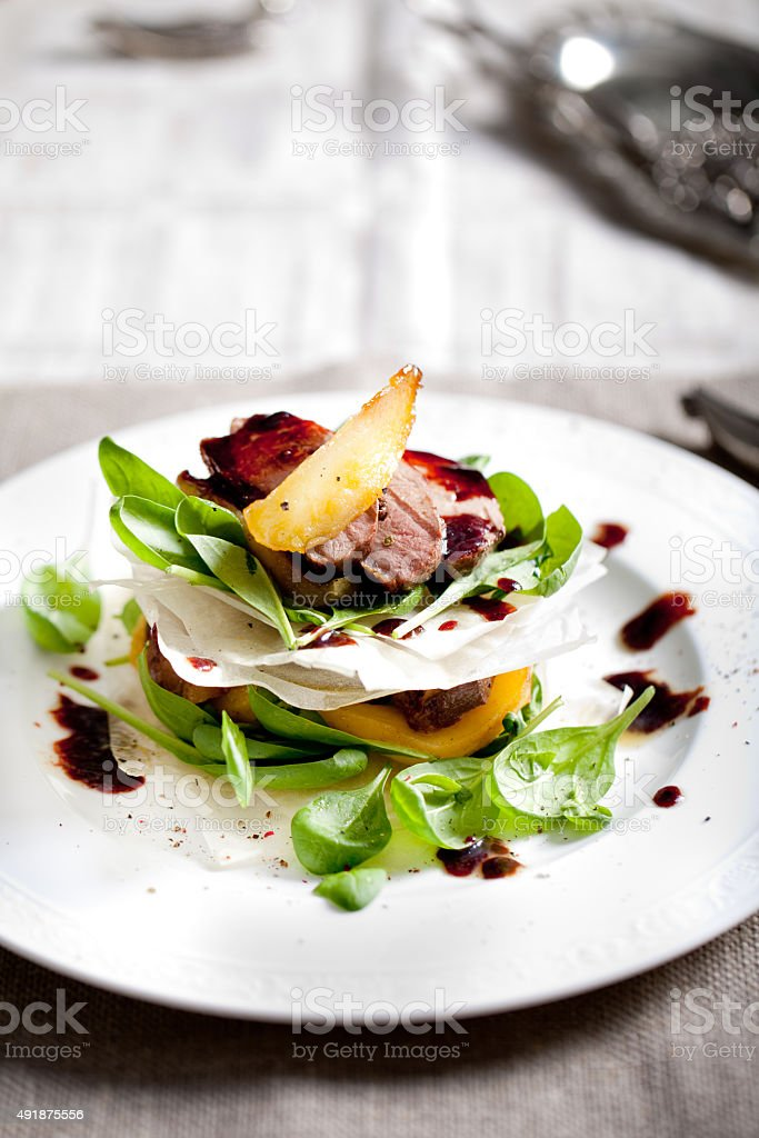 Duck breast roasted with salad, pear stock photo