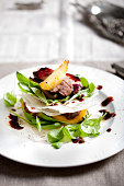 Duck breast roasted with salad, pear