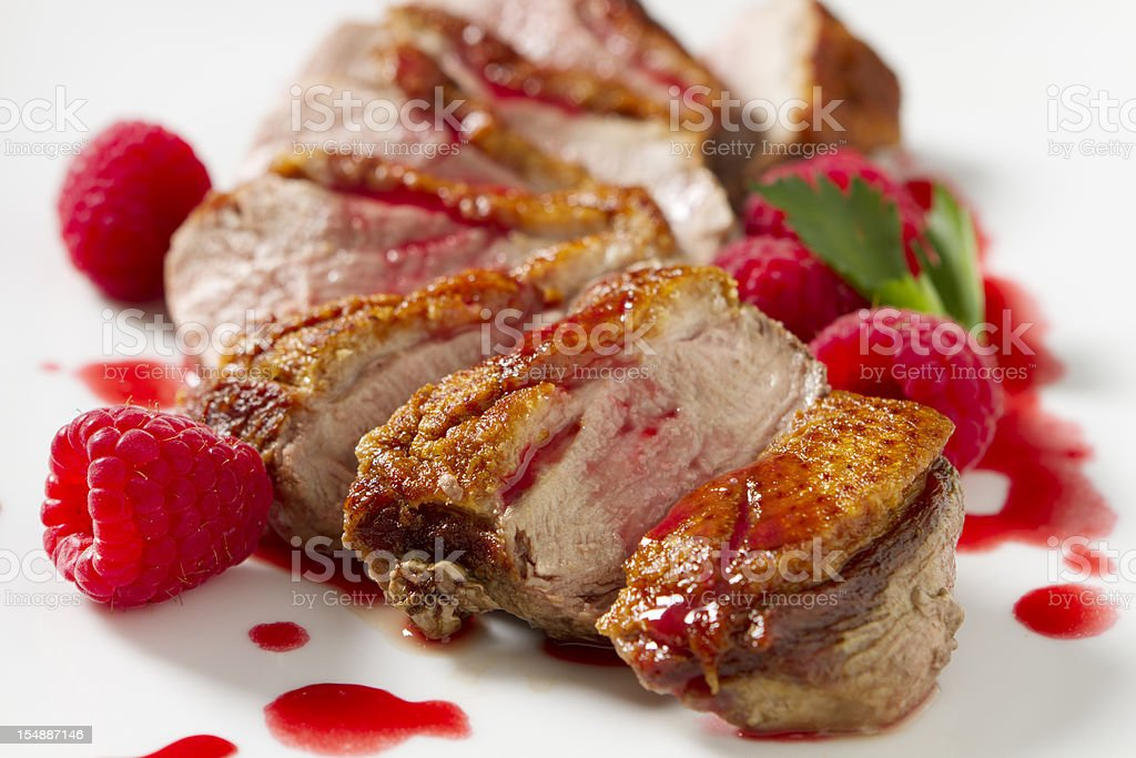 Duck Breast with Raspberry Sauce stock photo
