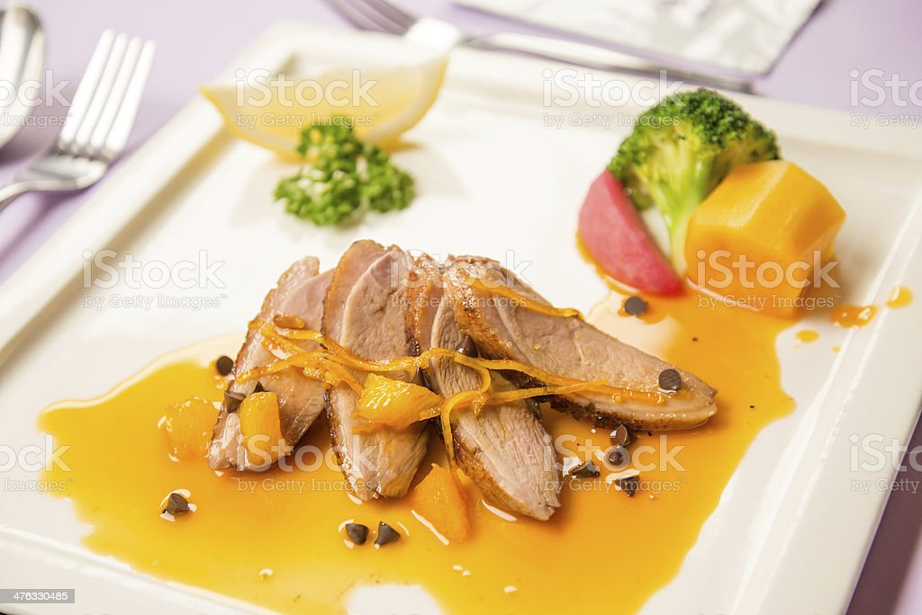Duck chest roasted with orange sauce Chinese style food royalty-free stock photo