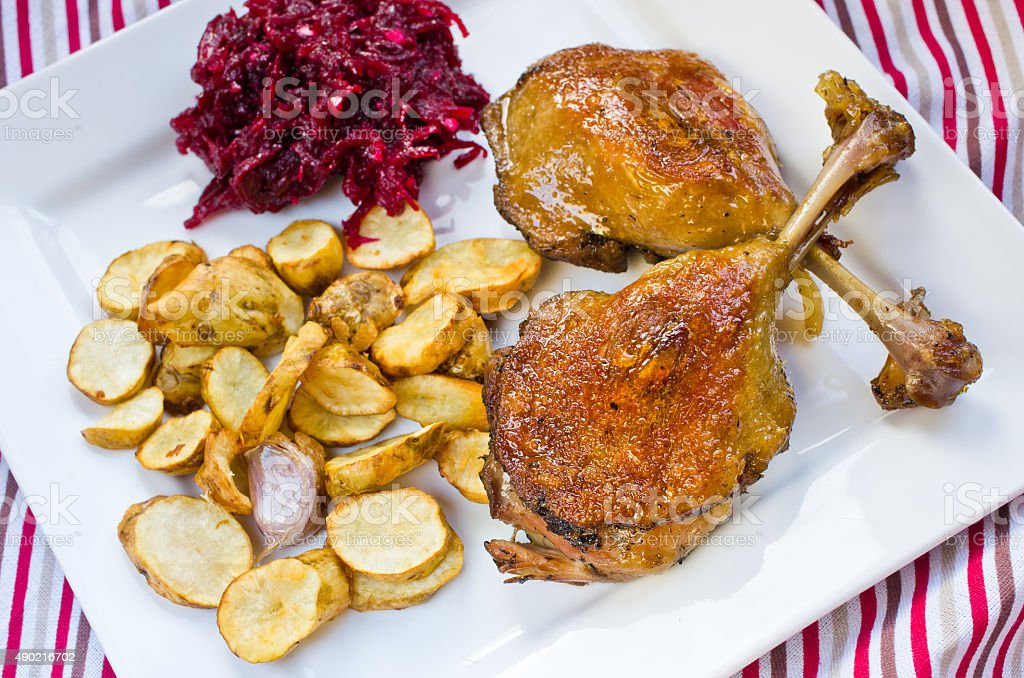 Duck confit with beetroots and jerusalem artichokes fries stock photo