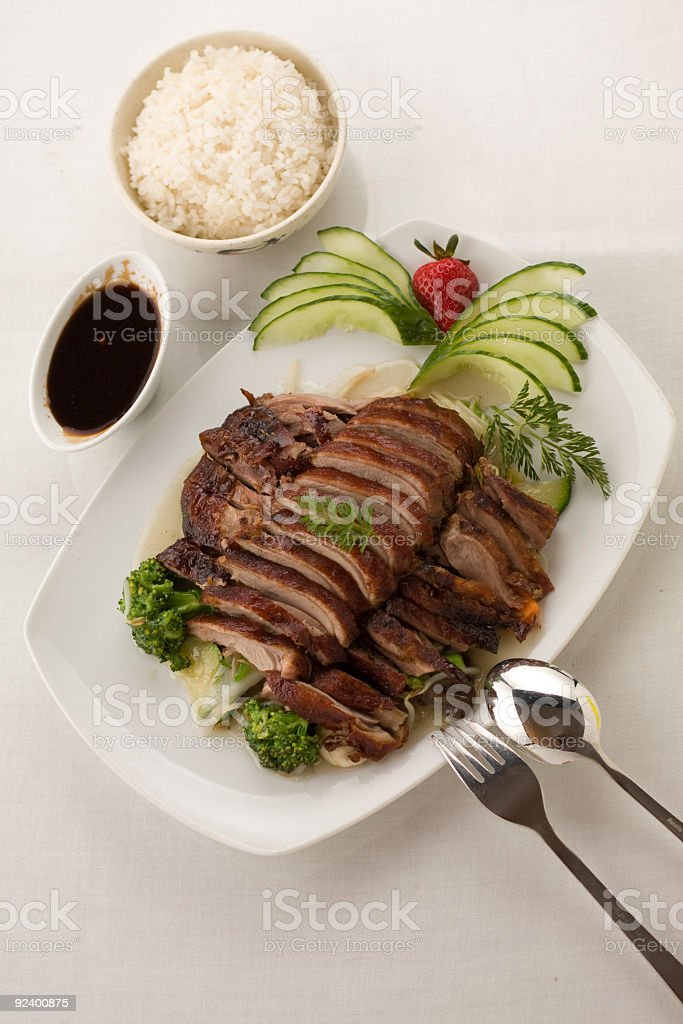duck crispy grilled, on mixed vegetables stock photo