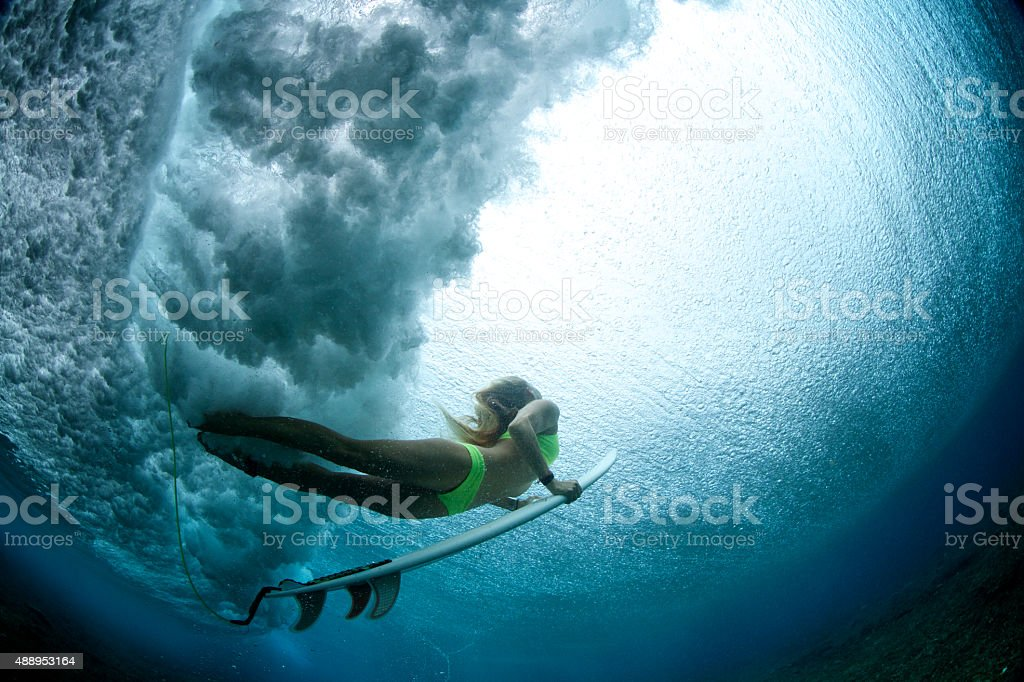 Duck dive from beneath the water stock photo