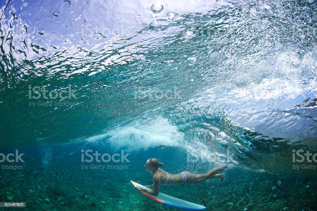 Duck dive surfer stock photo