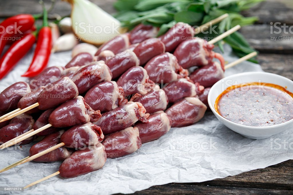 Duck Heart stringed on skewers BBQ with hot sauce and stock photo