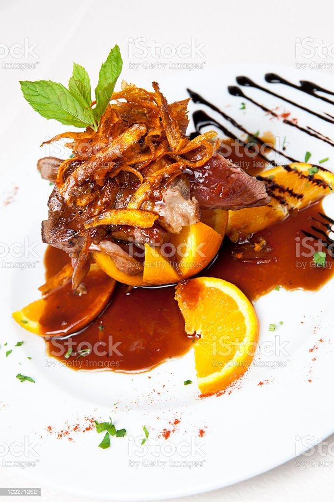 Duck in orange sauce stock photo