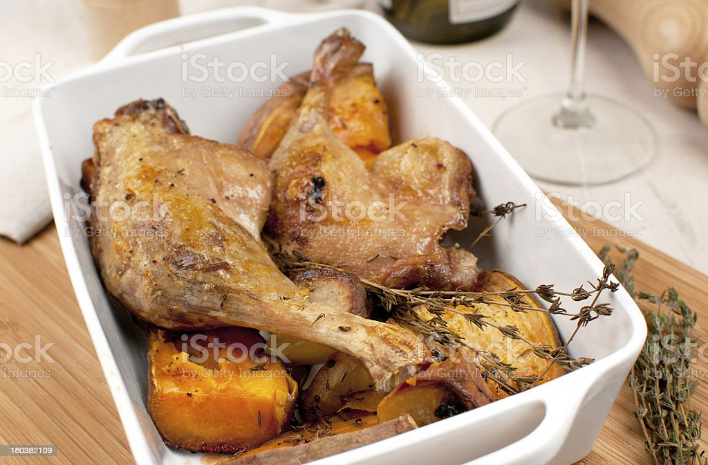 Duck legs closeup with thyme and sweet potato royalty-free stock photo