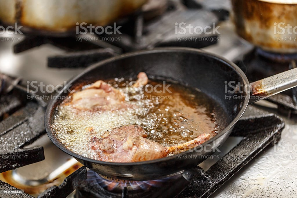 Duck legs frying stock photo