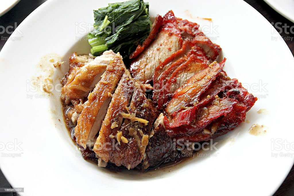 Duck meat and pork in white dish. stock photo